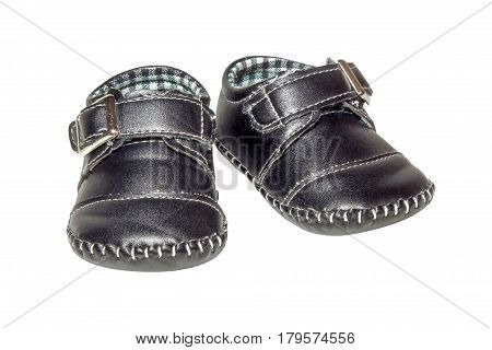 Baby dark blue leather booties isolated on white