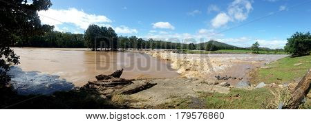 GOLD COAST, QUEENSLAND, AUSTRALIA - MARCH 31ST: Flood waters at the Coomera River Weir on 31st March, 2017 at Oxenford.