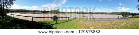 GOLD COAST, QUEENSLAND, AUSTRALIA - MARCH 31ST: Flood waters Panorama at the Coomera River Weir on 31st March at Oxenford.