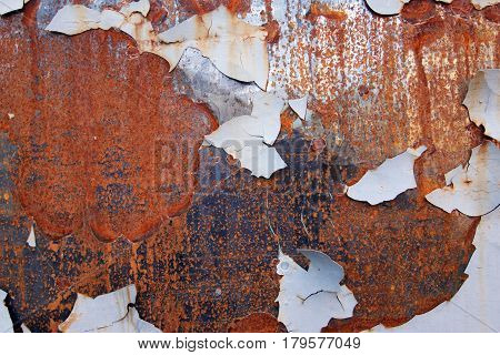 Rusty iron surface with peeling paint - grunge texture