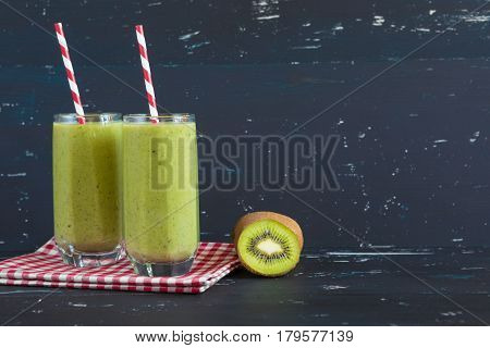 Healthy green smoothie with kiwi and spinach.