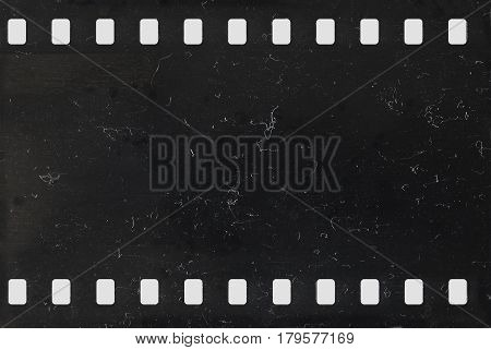 Strip of old celluloid film with dust and scratches - negative