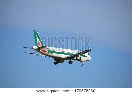 Amsterdam the Netherlands - July 15th 2016:EI-DSB Alitalia Airbus A320 approaching Polderbaan runway at Schiphol Amsterdam Airport arriving from Rome Italy