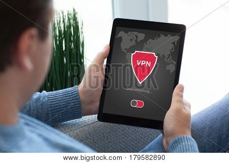 man holding tablet with app vpn creation Internet protocols for protection private network