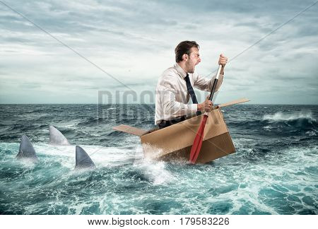 Fearful Businessman escapes screaming from sharks on a cardboard
