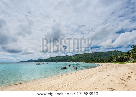 Anse Royale Mahe Island Seychelles - December 15 2015: Wide-angle view of the spectacular Anse Royale beach in cloudy weather Mahe Island Seychelles.