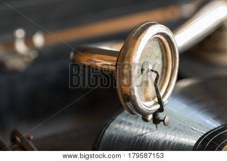 Old cantilever and gramophone record in closeup.