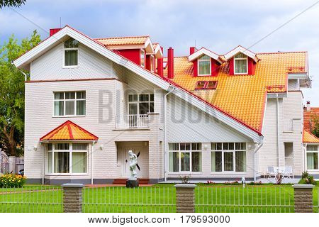 Luxury white Villa large panoramic windows decorated with stone and siding. Private residential house in the heart of Lithuanian resort Palanga. Klaipeda county Lithuania