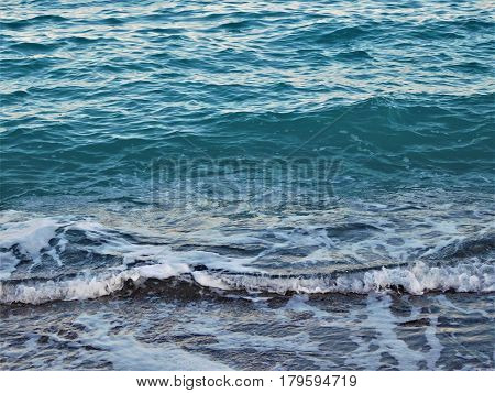 Mediterranean seashore. Foaming waves at the seashore
