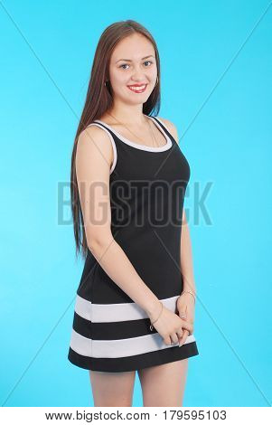 Cheerful young girl are standing against the blue background