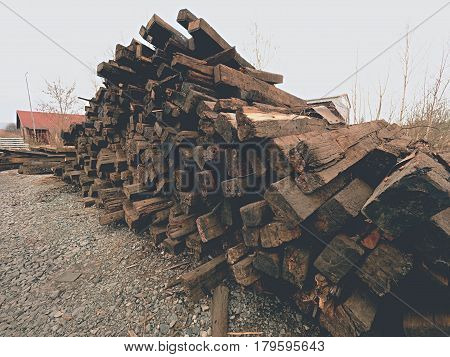 Extracted Old Wooden Ties In Stock. Old Oiled Used Oak Railway Sleepers Stored After Reconstruction