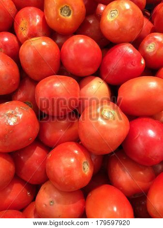 Delicious red tomatoes. Summer tray market agriculture farm full of organic tomatoes. Fresh tomatoes. It can be used as background.