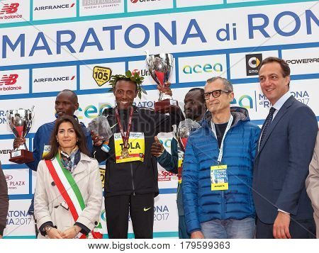 Rome Italy - April 2 2017: The mayor of Rome Virginia Raggi with other authorities on the stage with the top three finishers in the men's race of the 23rd marathon in Rome.