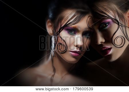 Mysterious portrait with reflection. Alter-ego. Girl with bright makeup and wet hair