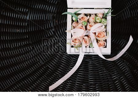 Floristic wedding box decoration in the tenderly light pink style on dark background