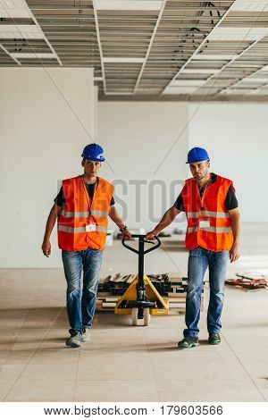 Workers With Hand Pallet Truck, Color Image