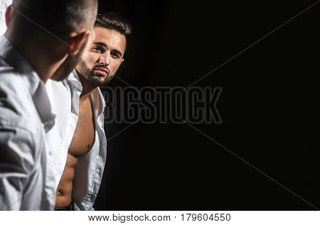Muscular Macho Man With Sexy Athlete Body Reflecting In Mirror