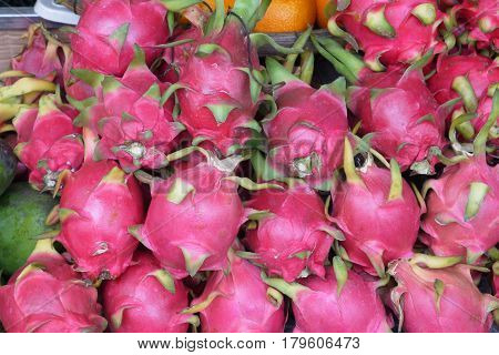 Fruit with a peel of brightly pink or red color, smooth with leaf outgrowths.
