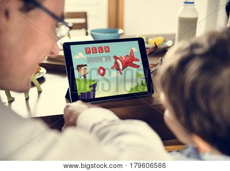 Son Using Tablet E-learning Game Education at Home