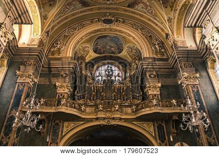 Brixen Italy - December 26 2016: Organ and choir loft above the entrance of the Cathedral of Santa Maria Assunta and San Cassiano in Bressanone.