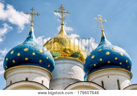 Domes of the Assumption Cathedral in Trinity Sergius Lavra in Sergiyev Posad near Moscow, Russia. The Trinity Lavra is one of the greatest of Russian monasteries.