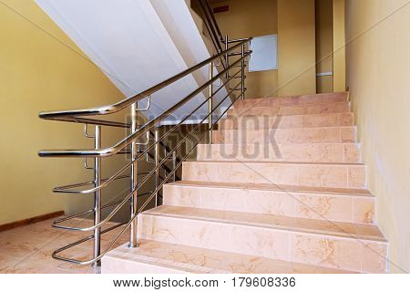 Staircase with metallic handrails in modern interior