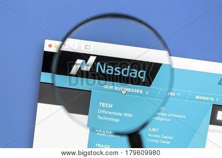 Ostersund, Sweden - Mars 31, 2017: The Nasdaq Stock Market website under a magnifying glass. Nasdaq is an American stock exchange.