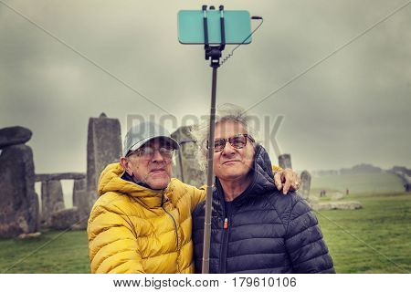 Mature Men Friends Take A Selfie In The Stonehenge Archaeological Site