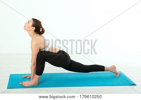 Sport. Fitness Yoga woman. Beautiful middle-aged woman doing yoga poses. Concept people are workout in yoga, training in sports clothes isolated