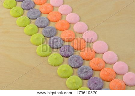 Multicolor white chocolate candy discs meltable for decorating food and craft projects