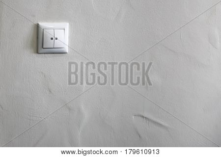 Switch of light on a white wall background