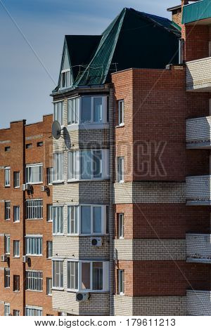 Brick house with balconies air conditioning satellite dish
