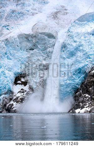 Ice Falling From Glacier In Alaska