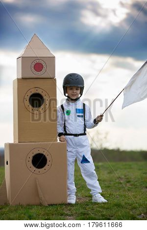 Adorable Little Boy, Dressed As Astronaut, Playing In Park