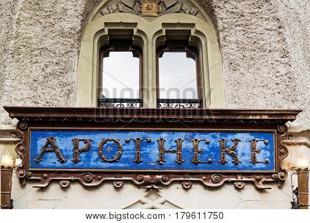 LUCERNE, SWITZERLAND - JUNE 05, 2016: Alte Suidtersche Apotheke medieval signboard  of the oldest pharmacy store in Lucerne was founded in 1833