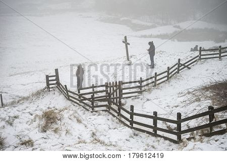 Beautiful Winter Landscape Image Around Mam Tor Countryside In Peak District England With Members Of