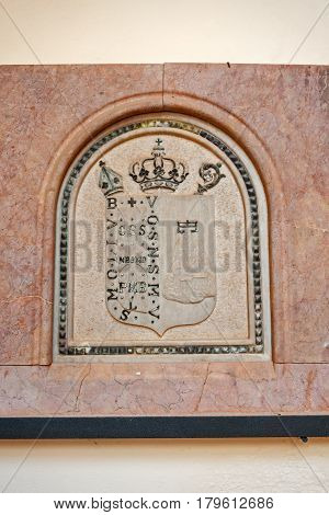 A crest in the cloister of the Santa Cueva de Montserrat, Benedectine Abbey near Barcelona