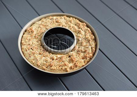Homemade wholegrain almond cake in torus form closeup