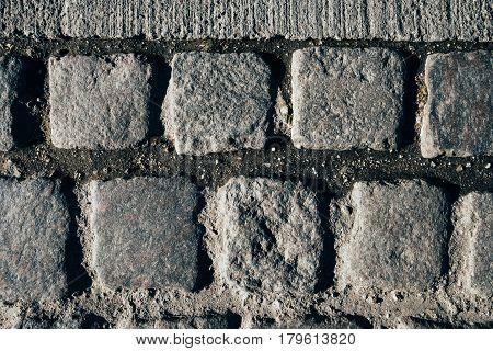 Cobblestone pavement texture top view of pedestrian walkway from Copenhagen Denmark.