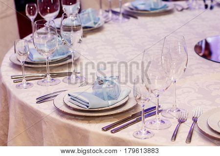 Luxury Wedding Reception. Stylish Glasses, Plates On Napkins And Silver Cutlery And Gifts For Guest