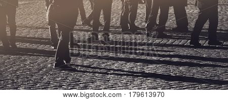 Crowd group of people on the street pedestrians walking on public location general public concept for community and population themes selective focus