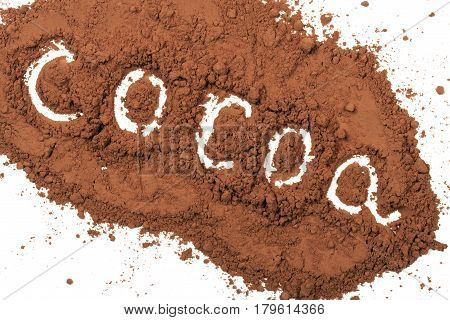 word cocoa written in cocoa powder isolated on white background.