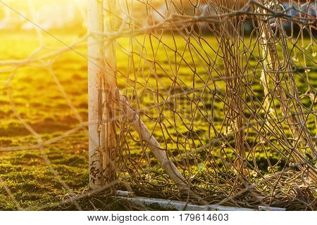 Soccer goalpost and net on practicing pitch as abstract sport and football background selective focus