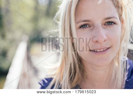 Natural beauty, female portrait outdoor, windy weather