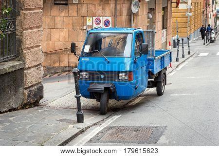 SANTA MARGHERITA LIGURE - DECEMBER 2016: Traditional Italian three wheel car Piaggio Ape staying parked on the street.