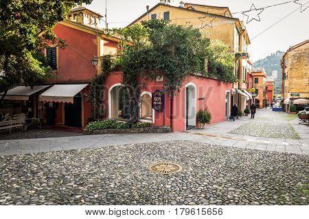 PORTOFINO, ITALY - DECEMBER 2016: Stony street with beautiful cafe at Portofino town, Liguria, Italy