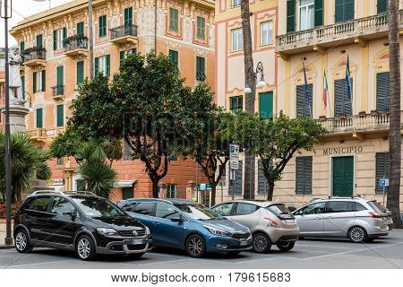 SANTA MARGHERITA LIGURE, ITALY - DECEMBER 2016: Parked cars under citrus trees in Santa Margherita Ligure, Italy