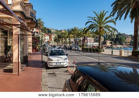 SANTA MARGHERITA LIGURE, ITALY - DECEMBER 2016: Parked cars along the street near the coastline of Mediterranean sea.