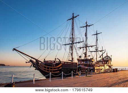 A touristic pirate ship at the piere (molo) in Sopot Poland in sunrise light