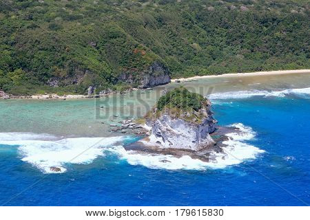 Aerial view of Bird Island, Saipan Bird Island, one of the most popular tourist destinations on Saipan, Northern Mariana Islands as seen from an airplane window
